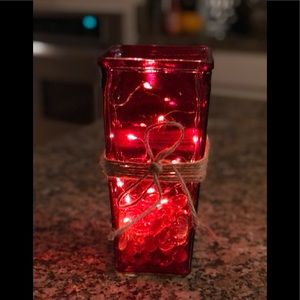 Red vase with fairy lights